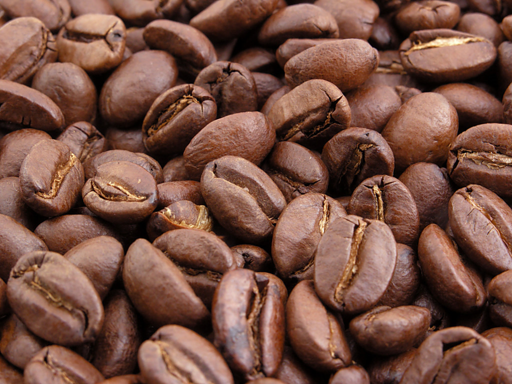 I prefer medium roasted beans - they'll be the color of milk chocolate, and won't be shiny (or oily)